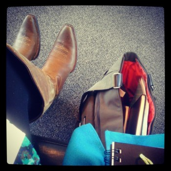 My boots and travel necessities: the notebooks, the books, the pens. :)
