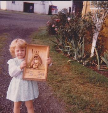 Little Paige posting with a gift for me from Grandpa--a carving of Leo the Lop, from a series of books that I loved.