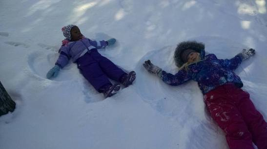 My nieces taking a snow angel break on our day of sledding. :)