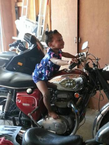 BSA Baby. My niece. No worries about her adorable feet. The bike isn't warm. :)