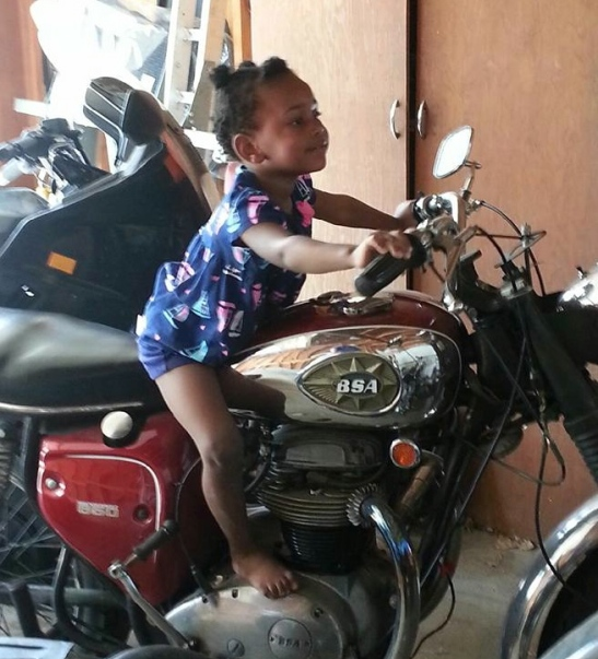 BSA Baby. My niece. No worries about her adorable feet. The bike isn't warm.